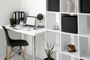 office-desk-with-laptop-and-chair-next-to-shelf